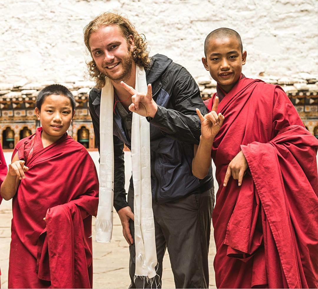 Michael with two young monks. Photo: Global Degree